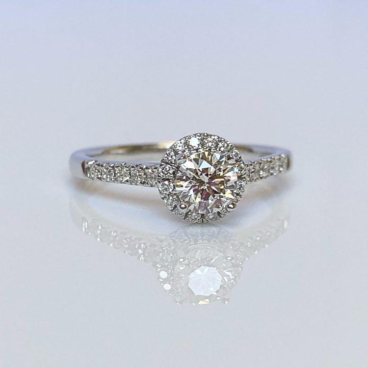 18ct White Gold & 0.73ct Diamond Halo Engagement Ring