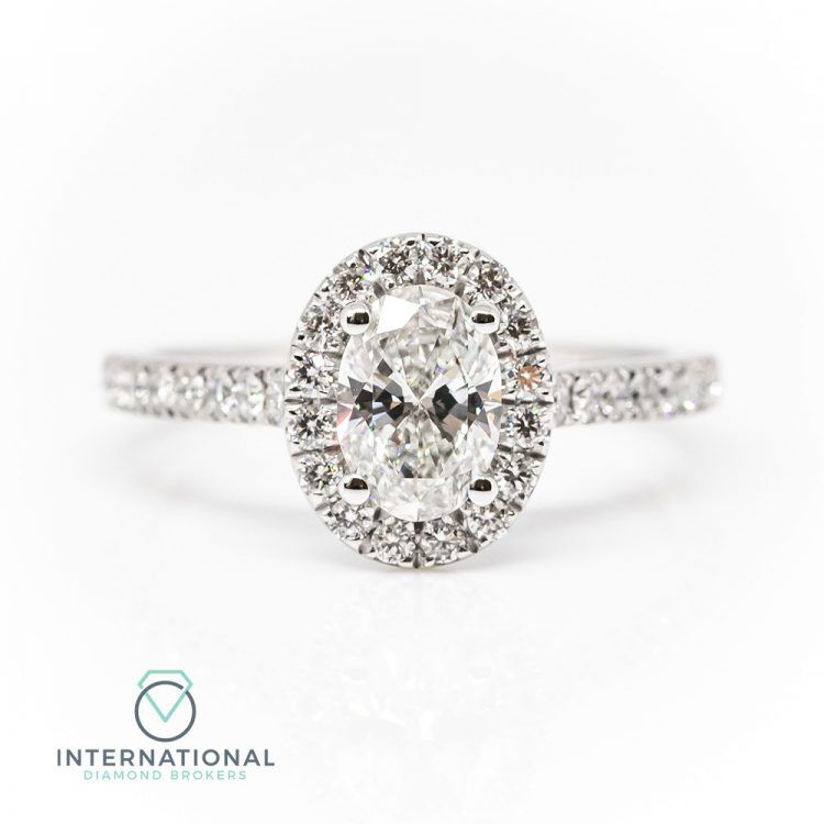 18ct White Gold & 0.80ct Oval Diamond Halo Engagement Ring