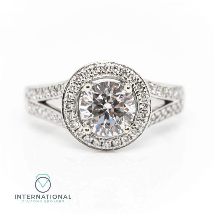 18ct White Gold & 1.26ct Diamond Halo Engagement Ring