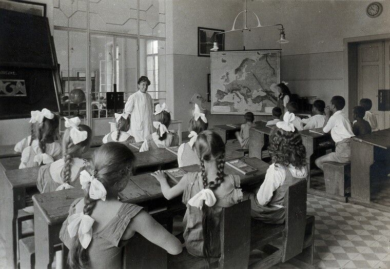 Children learning geography in the hospital school. Photograph, 1921