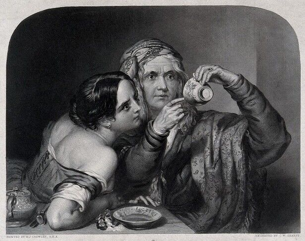 An old fortune-teller is reading a young woman's fortune by looking at tea leaves at the bottom of a cup