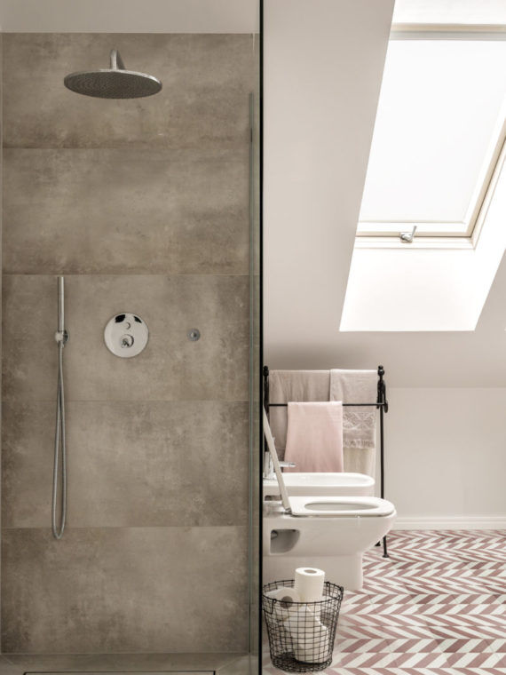 Concrete shower in bathroom