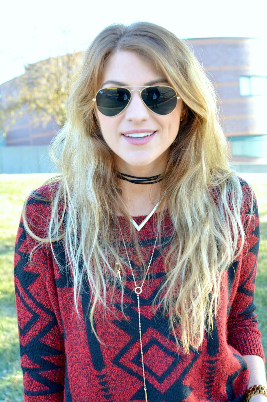 b09be4ba86 Ashley from LSR in a red and black sweater with a Vanessa Mooney choker