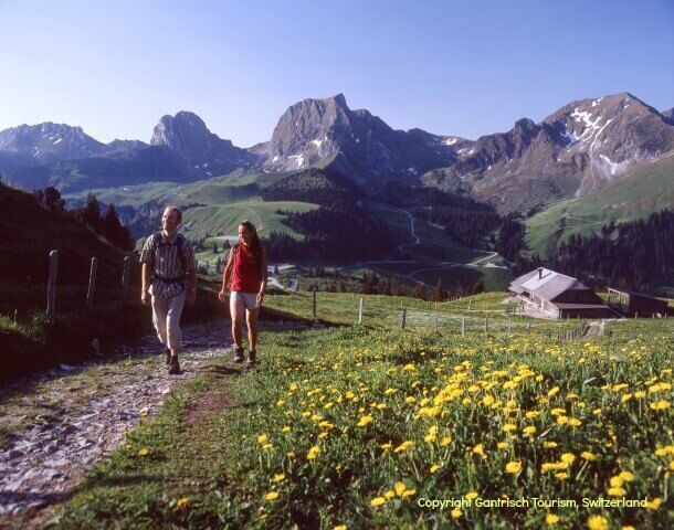 couple walking in the Swiss alps