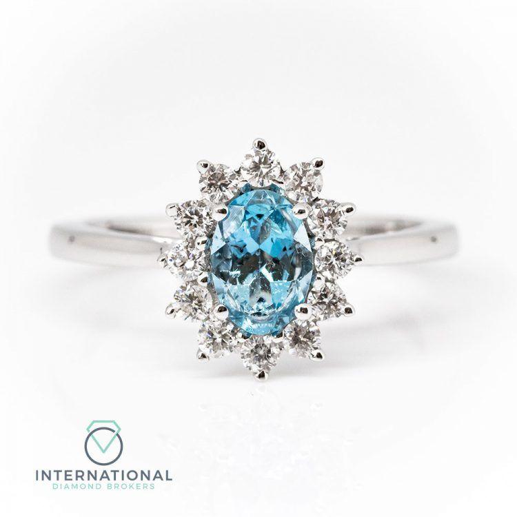 18ct White Gold, Oval Aquamarine & Diamond Cluster Ring