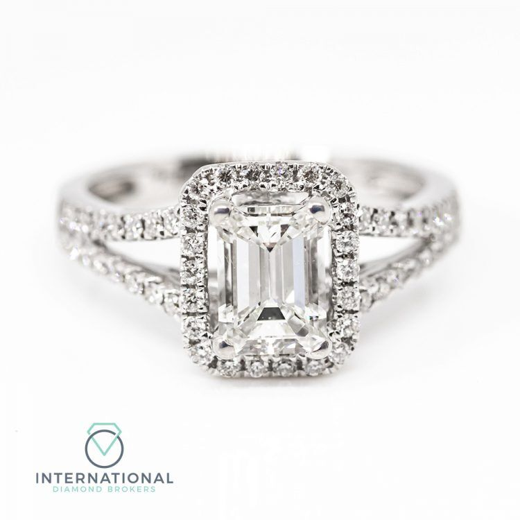18ct White Gold & 1.35ct Emerald Cut Diamond Halo Engagement Ring