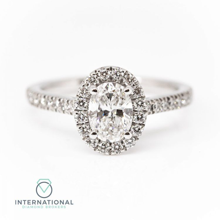 18ct White Gold & 1.00ct Oval Diamond Halo Engagement Ring