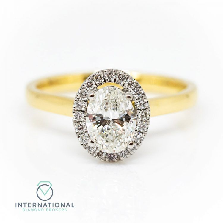 18ct Yellow Gold & 1.05ct Oval Diamond Halo Engagement Ring