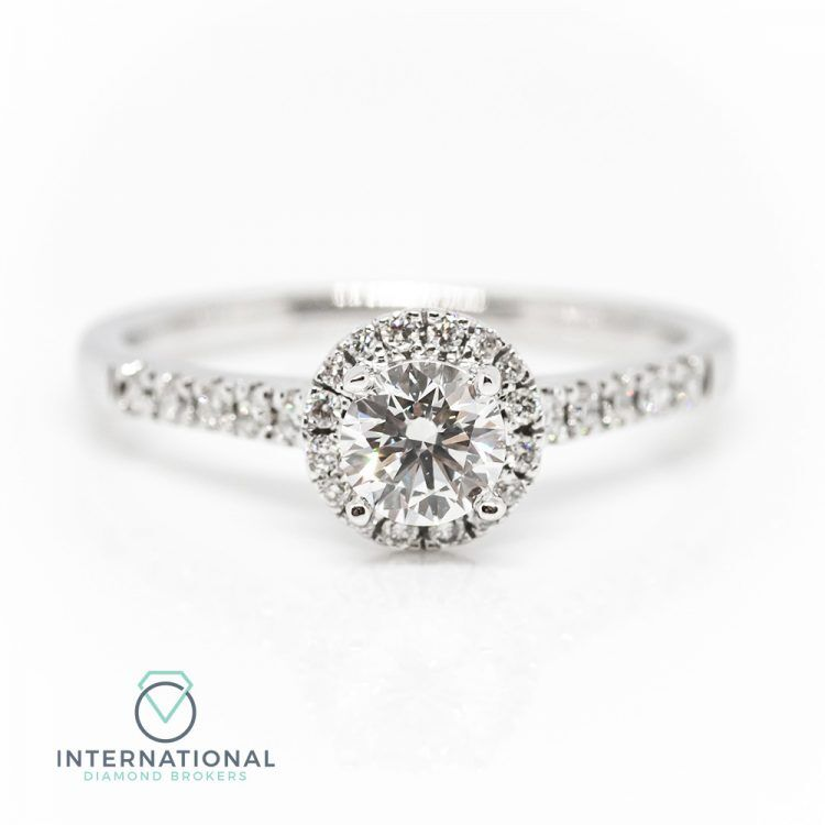 18ct White Gold & 0.73ct Diamond Halo Engagement Ring