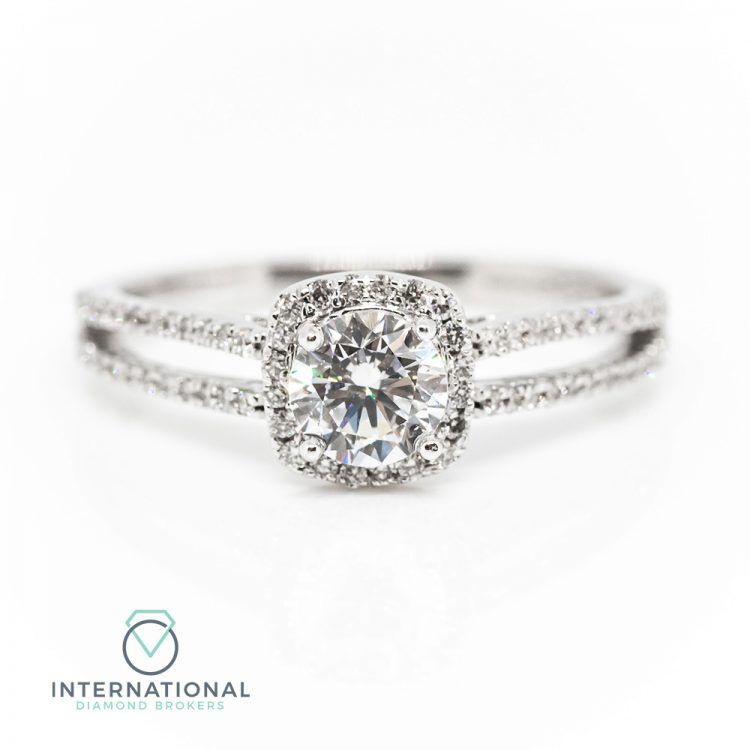 18ct White Gold & 0.76ct Diamond Halo Engagement Ring