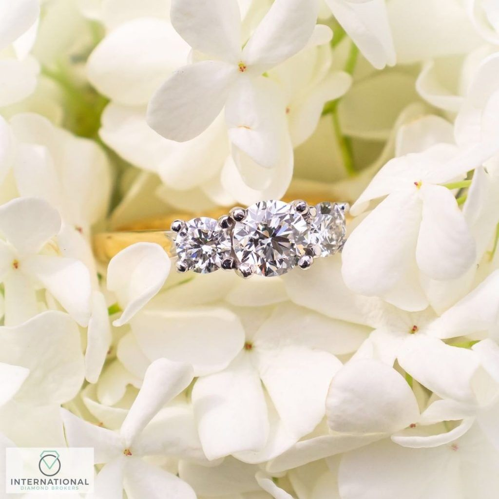 engagement ring on white flowers