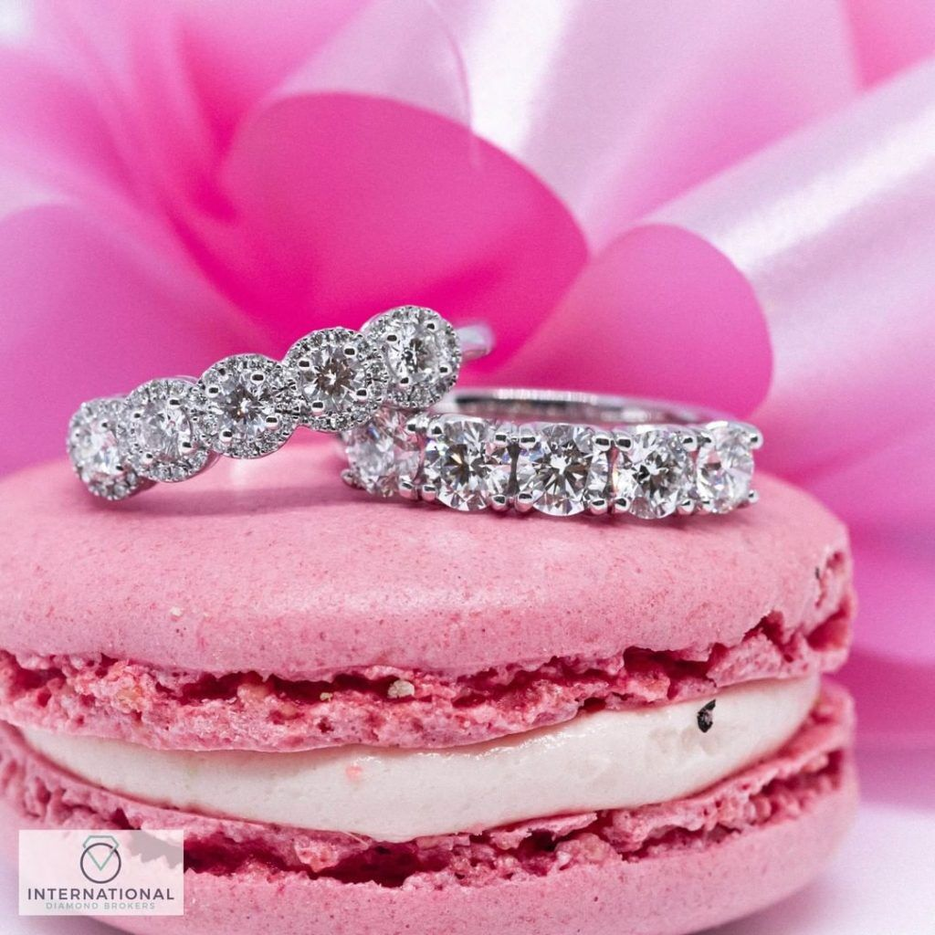 engagement rings on pink macaroon