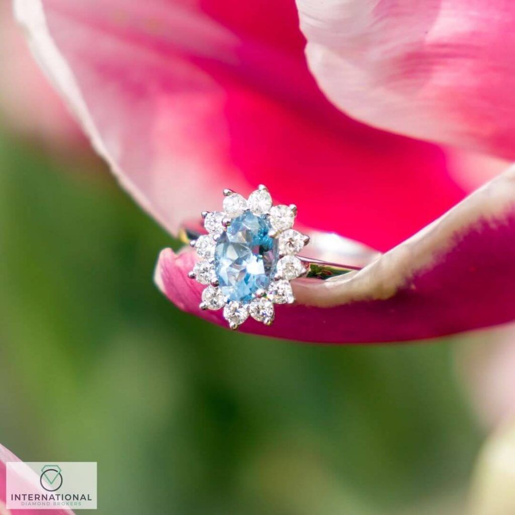 aquamarine diamond ring on pink and green