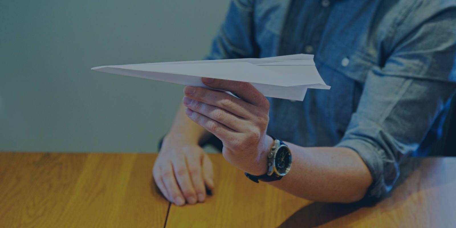 Matt Konen creating a paper airplane at the Big Storm office in Bozeman, MT