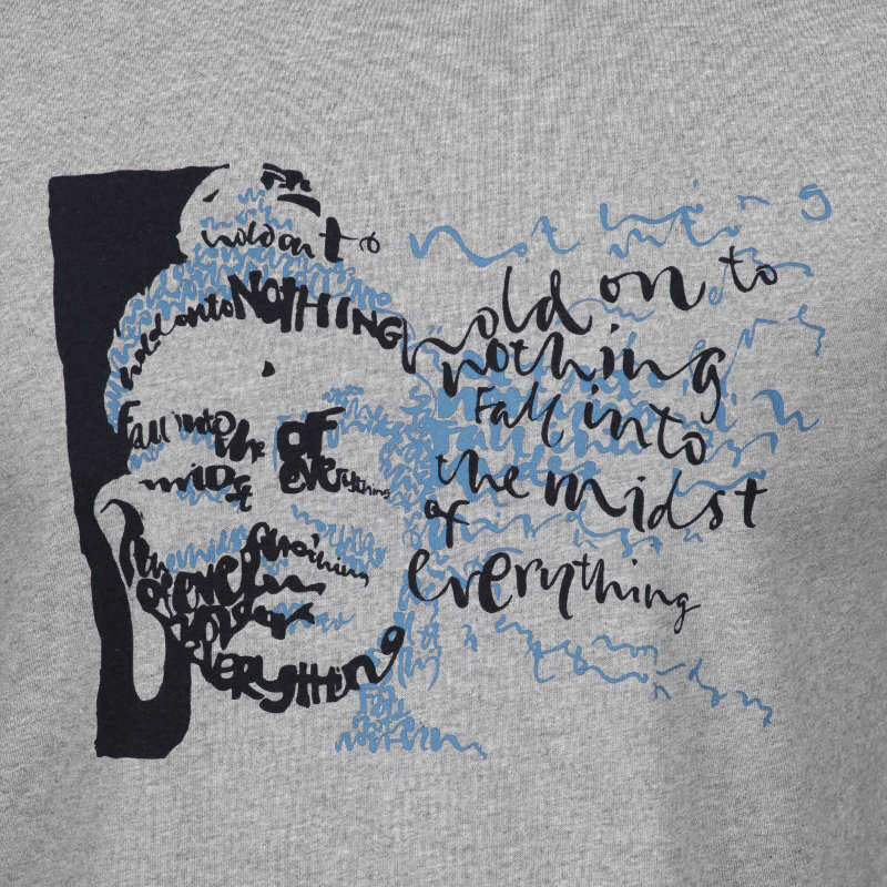 Detail of the Buddhist T-shirt 'Hold on to Nothing & Fall into the Midst of Everything,' creating the face of Buddha out of calligraphy